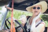 Attractive Woman in Twenties Outfit Driving an Antique Automobil — Stock Photo
