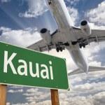 Kauai Green Road Sign and Airplane Above — Stock Photo