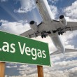 Las Vegas Green Road Sign and Airplane Above — Stock Photo #54209045
