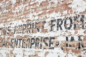 Old Weathered Brick Wall with Advertisement — Stock Photo