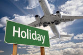 Holiday Green Road Sign and Airplane Above — Stockfoto