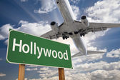 Hollywood Green Road Sign and Airplane Above — Stock Photo