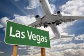Las Vegas Green Road Sign and Airplane Above — Stock Photo