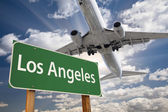 Los Angeles Green Road Sign and Airplane Above — Stock Photo