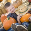 Two Little Boys Playing in Wheelbarrow at the Pumpkin Patch — Stock Photo #54416831