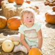 Adorable Baby Girl Holding a Pumpkin at the Pumpkin Patch — Stock Photo #54417109