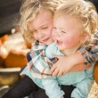 Little Boy Playing with His Baby Sister at Pumpkin Patch — Stock Photo #54417207