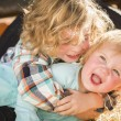 Little Boy Playing with His Baby Sister at Pumpkin Patch — Stock Photo #54417247