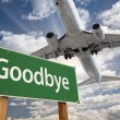 Goodbye Green Road Sign and Airplane Above — Stock Photo #54417679