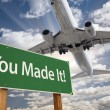 You Made It Green Road Sign and Airplane Above — Stock Photo #54417757