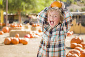 Little Boy Holding His Pumpkin at a Pumpkin Patch — Stok fotoğraf