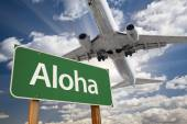 Aloha Green Road Sign and Airplane Above — Stock fotografie