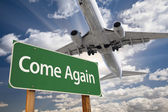 Come Again Green Road Sign and Airplane Above — Stock Photo
