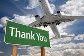 Thank You Green Road Sign and Airplane Above — Stockfoto