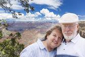 Happy Senior Couple Posing on Edge of The Grand Canyon — Stock Photo