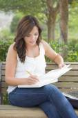 Young Adult Female Student on Bench Outdoors — Stock Photo