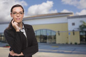 Woman In Front of Commercial Building — Stock Photo