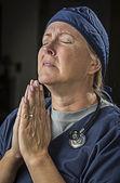 Pleading in Prayer Female Doctor or Nurse — Stock Photo