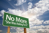 No More - She Was Asking For It Green Road Sign — Stock Photo