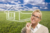 Woman and Grass Field with Ghosted House Figure Behind — Stock Photo