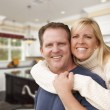 Happy Couple Inside Beautiful Custom Kitchen — Stock Photo #56285541