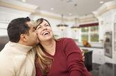 Mixed Race Couple Kissing Inside Beautiful Custom Kitchen — Stock Photo