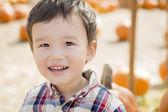 Mixed Race Young Boy Having Fun at the Pumpkin Patch — ストック写真
