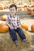 Mixed Race Young Boy Having Fun at the Pumpkin Patch — Stok fotoğraf