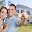 Military Couple with House Keys In Front of New Home — Stock Photo #56953717
