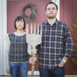Fun Mixed Race Couple Portrait Simulating the American Gothic Pa — Stock Photo #56954197