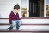Melancholy Mixed Race Boy Sitting on Front Porch Steps — Stock Photo