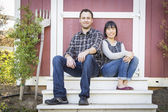 Mixed Race Couple Relaxing on the Steps — Stock Photo