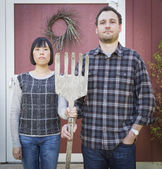 Fun Mixed Race Couple Portrait Simulating the American Gothic Pa — Stock Photo
