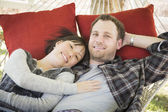 Mixed Race Couple Relaxing in a Hammock — Stock Photo