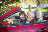 Happy Chinese Couple Enjoying An Afternoon Drive in Their Conver — Stock Photo