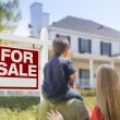 Family Facing For Sale Real Estate Sign and House — Stock Photo #57624057