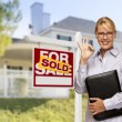 Real Estate Agent in Front of Sold Sign and House — Stock Photo #57623959
