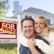 Couple in Front of New House and Sold Sign — Stock Photo #57623971