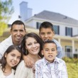 Hispanic Family in Front of Beautiful House — Stock Photo #57623999