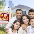 Hispanic Family in Front of Sold Real Estate Sign, House — Stock Photo #57624001