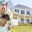 Attractive African American Family in Front of Home — Stock Photo #57624005