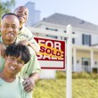 African American Family In Front of Sold Sign and House — Stock Photo #57624015