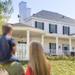 Mixed Race Young Family Looking At Beautiful Home — Stock Photo #57624055