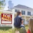 Family Facing Sold For Sale Real Estate Sign and House — Stock Photo #57624059