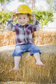 Young Mixed Race Boy Laughing with Hard Hat Outside — Stock Photo