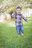 Cute Young Mixed Race Boy Playing Football Outside — Stock Photo