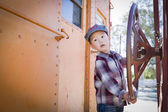Cute Young Mixed Race Boy Having Fun on Railroad Car — Stock Photo