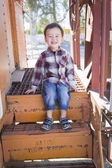 Cute Young Mixed Race Boy Having Fun on Railroad Car — Stock Photo