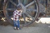 Cute Young Mixed Race Boy Having Fun Near Antique Machinery — Stockfoto