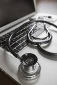 Medical Stethoscope Resting on Laptop Computer — Foto de Stock